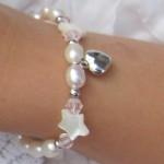 zilveren kinderarmbandje Sparkling Star met hartje en Parelmoer sterren